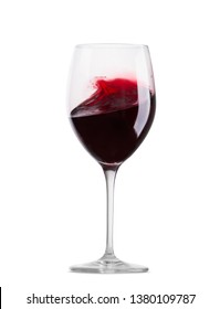 Red wine glass with wine in motion isolated on white background