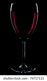 Red wine glass on the black background