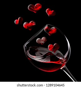 Red wine glass plash with flying hearts