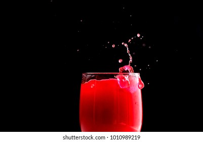 Red wine glass with splash in High Speed Shot