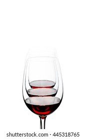 Red wine glasses arranged and isolated on white background