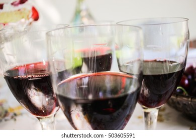 Red wine in glasses at birthday party closeup