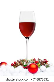 Red wine glasses with christmas decoration on white background
