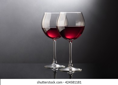 Red wine glasses isolated on black