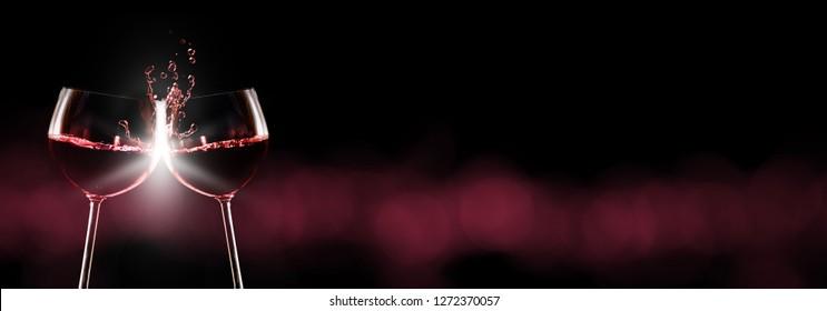 Red wine, red wine glasses toast, dark background