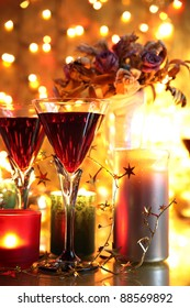Red wine in glasses,candle lights,flowers and twinkle light background.