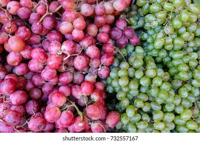 red wine grapes background, white grapes,background in a local market bunch of grapes ready to eat