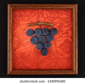 Red wine grapes bunch in a frame isolated on red background