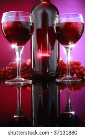 Red wine, grapes and glasses