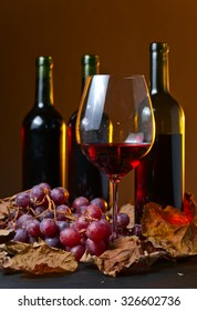 red wine with grapes and vine leaves