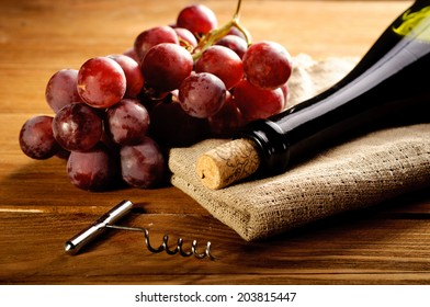 Red wine and grapes in vintage setting