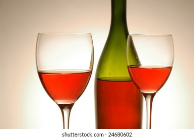 Red wine and green bottle