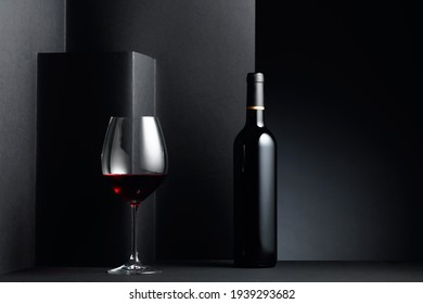 Red wine on a black background. Copy space.