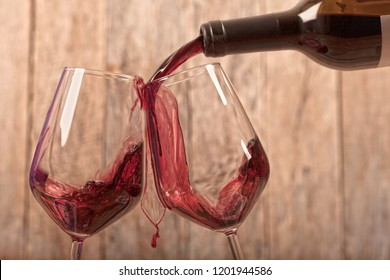 red wine over wooden table