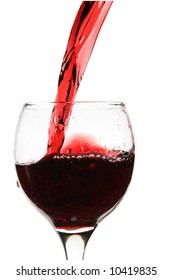 Red wine pour into glass close-up isolated over white background