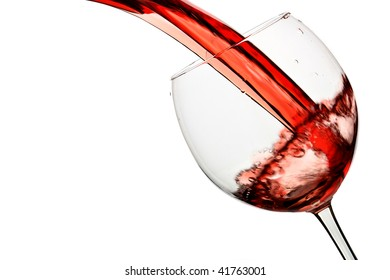 Red wine pour into glass isolated over white background