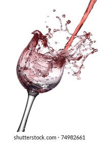 Red wine pour and splash in a glass