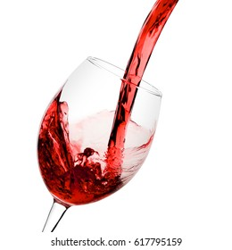 red wine poured from a bottle into wineglass on white background, isolated