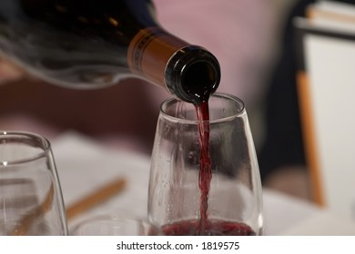Red wine poured during a wine tasting