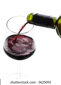 red wine poured to a glass from a bottle