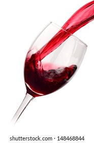 Red wine poured into a glass isolated on white