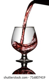 Red Wine Poured into a glass from bottle