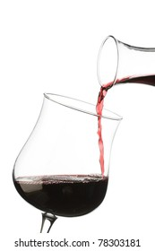 red wine pouring from decanter into glass