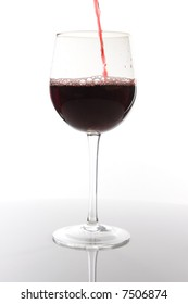 Red wine pouring down on white background