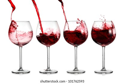 Red wine pouring in four glasses
