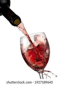 Red wine pouring in a glass, close up