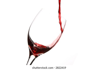 red wine pouring into a glass, horizontal on white background