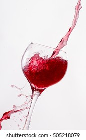 Red Wine Pouring into glass white isolated