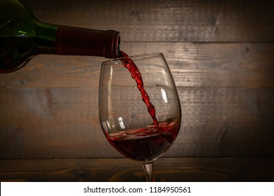 Red Wine Pouring into a  wineglass from a bottel