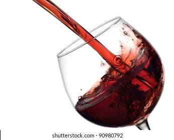 Red wine pouring into a wineglass