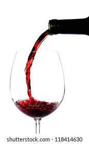 Red wine pouring splashing on a glass on white