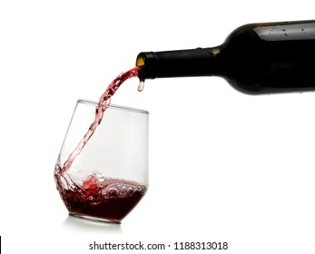 Red wine pouring in a stemless glass