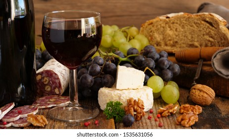 red wine with salami, grape and cheese