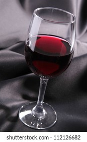 red wine and silk drape