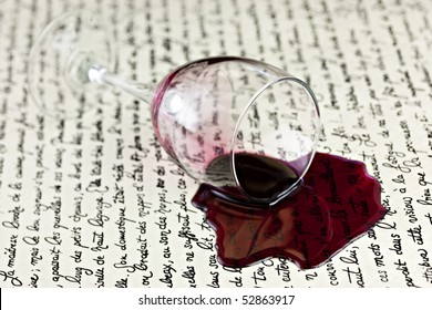 Red Wine Spilled On White Parchment Paper