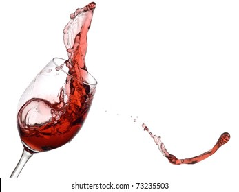 Red wine splash and flying out of the glass