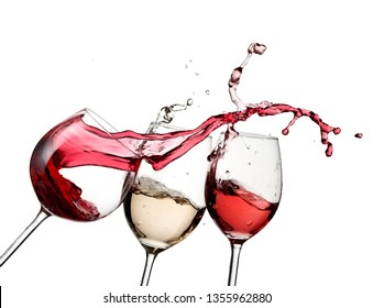 Red wine splash over white and rose wine glasses