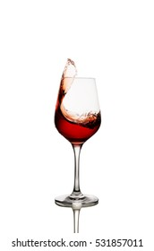 Red wine splashing from glass isolated on white background