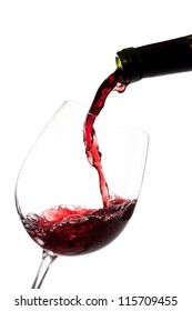 Red wine splashing on  a glass and bottle