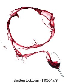 Red wine splashing out of glass in circle, isolated on white background