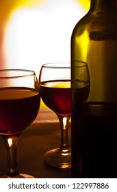 red wine in two glasses on a red background