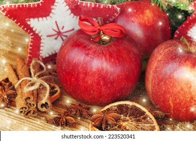 Red winter apples with cinnamon sticks and anise.