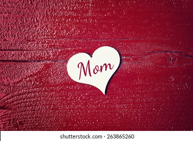 red wood background with hearts - mom