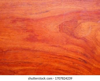 red wood background. texture of teak wood. laminate plywood floor