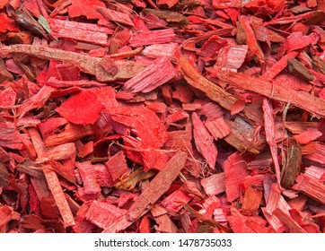 Red wood chips used as organic mulch in the garden. Winterization & conservation of soil. Biomass. Bioenergy
