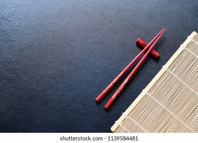 red wood chopsticks on black table background,Copy space.